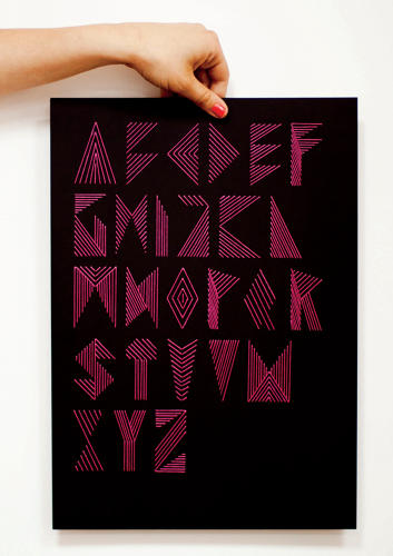 <p>Polish designer <a href=&quot;http://ninagregier.com/&quot; target=&quot;_blank&quot;>Nina Gregier</a> embroiders herringbone-like letterforms onto black card stock with needle and thread. (She plots the letters on graph paper or draws them in Illustrator first, then punches corresponding holes into the thick paper.)</p>