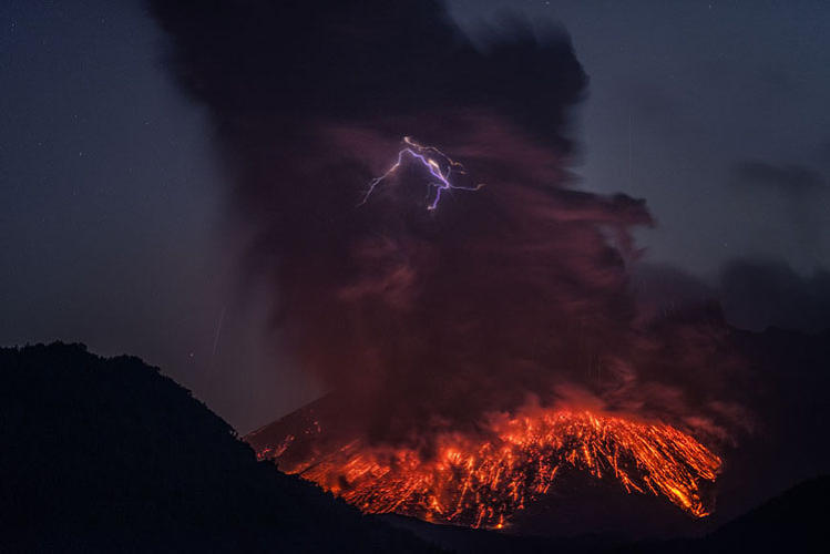 <p>It sometimes occurs at the mouth of the volcano as it's erupting, and seems to stem from the collision of highly charged lava and rocks.</p>