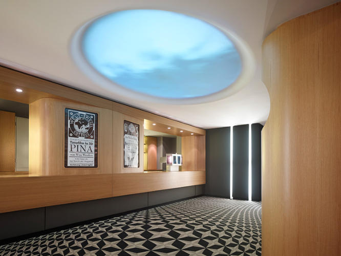 <p>An elliptical ceiling projection and graphic carpet.</p>