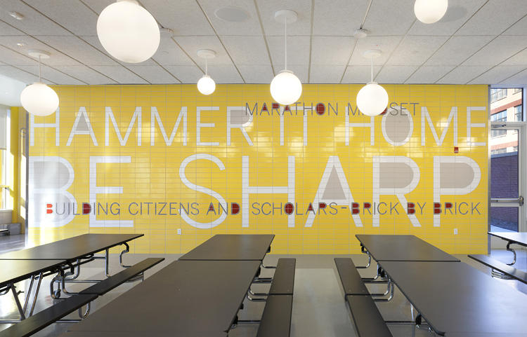 <p>The cafeteria is a visual cacophony of encouragement, writ in yellow and red tile.</p>