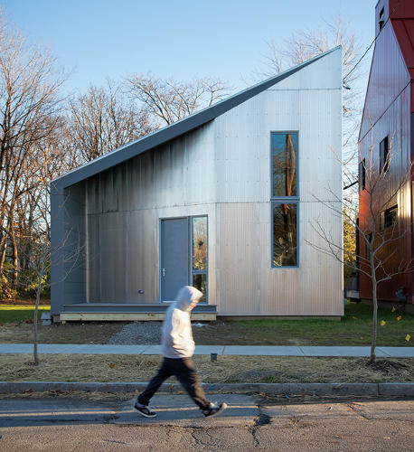 <p>R-House is the winning entry of a competition sponsored by the Syracuse University School of Architecture to design an affordable single-family house for Syracuse's Near Westside neighborhood. ARO (Architecture Research Office) and Della Valle Bernheimer collaborated on the project, an unusual form with corrugated-aluminum cladding and a steep, asymmetrical roof.</p>