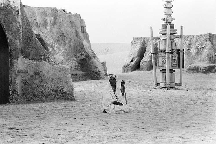 <p>An image from Rä di Martino's &quot;Every World's A Stage&quot; set among the remnants of films sets used in <em>Star Wars.</em></p>