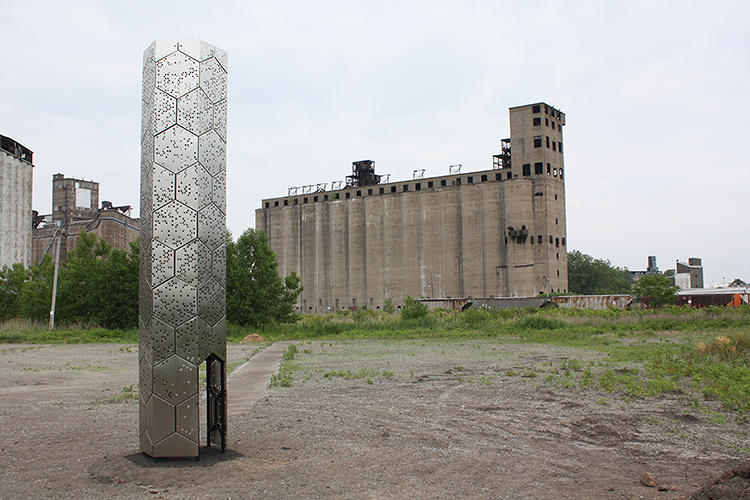 <p>According to its designers, the tower's form echoes that of the surrounding silos, particular in its proportions.</p>