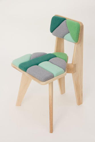 <p>The collection features chairs, stools, and benches with a geometric flair.</p>