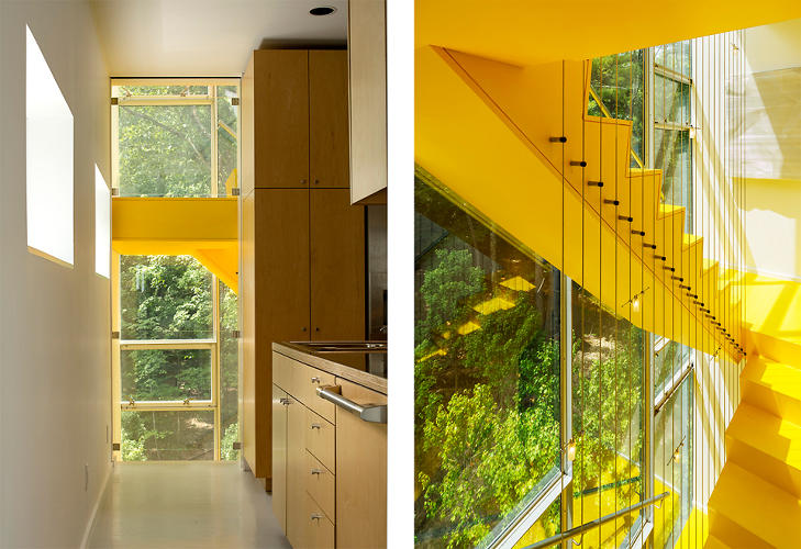 <p>The sculpturally framed staircase is painted bright yellow that pops from the forest's green hues. It also acts like a &quot;solar chimney&quot; that absorbs the sun's heat during the day and funnels it out of the house through a roof vent.</p>