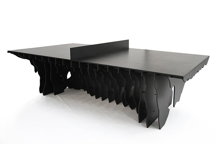 <p>Designed by Brooklyn-based studio Snarkitecture, the table is made from jet-black Richlite and rubber. The top half functions like any other ping pong table, but the bottom half…</p>