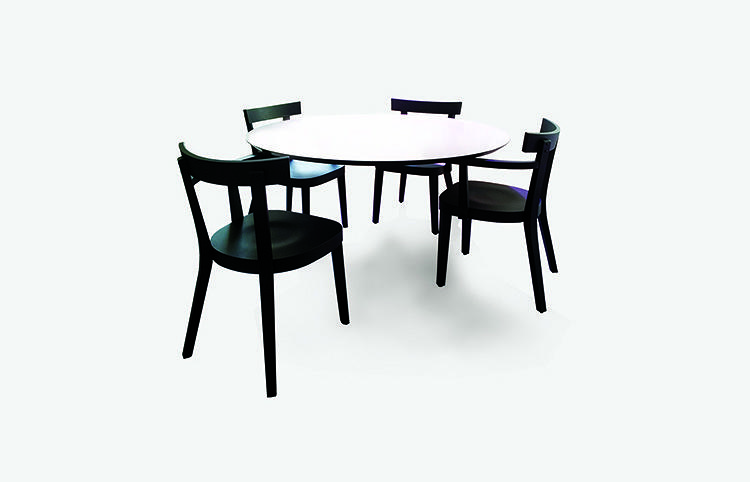 <p>The surface of Ingo Maurer's Floating Table for Established &amp; Sons sits atop the specially designed armrests of the chairs that surround it.</p>