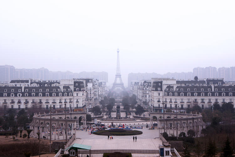 <p>A 108-meter copy of the Eiffel Tower looms over Tianducheng, a development outside Shanghai modeled after a typical Haussamannian boulevard.</p>