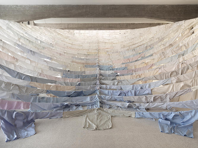 <p>Her pieces typically have environmental undertones, and <em>Are We Still Going On?</em> is no exception. Kaikkonen strung together used button down dress shirts to create the shape of a ship vessel.</p>