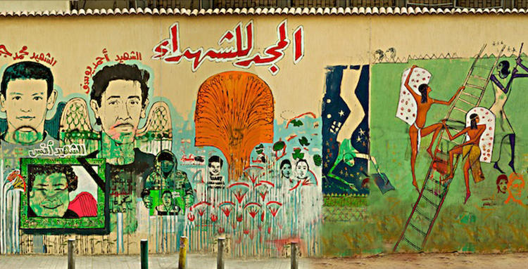<p><em>Walls of Freedom</em> documents the story of the Egyptian Revolution through street art. Here, in a photo by Munir Sayegh from February 2012, Ammar Abou Bakr, Alaa Awad, and Hanaa Degham's Martyr Mural, commemorating those who died in the Port Said Massacre.</p>