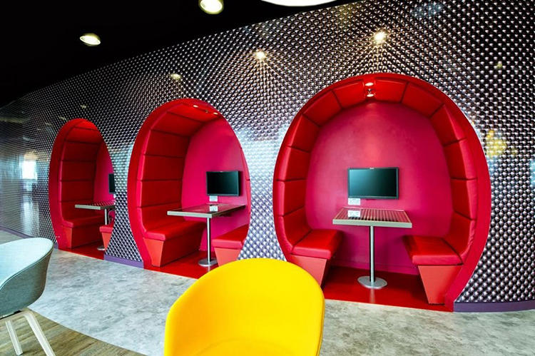<p>Semi-private booths give employees a space to take lunch or huddle together in  conference.</p>