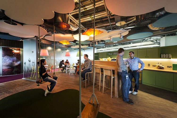 <p>It's centered around a large kitchen where employees socialize and hash out ideas together.</p>
