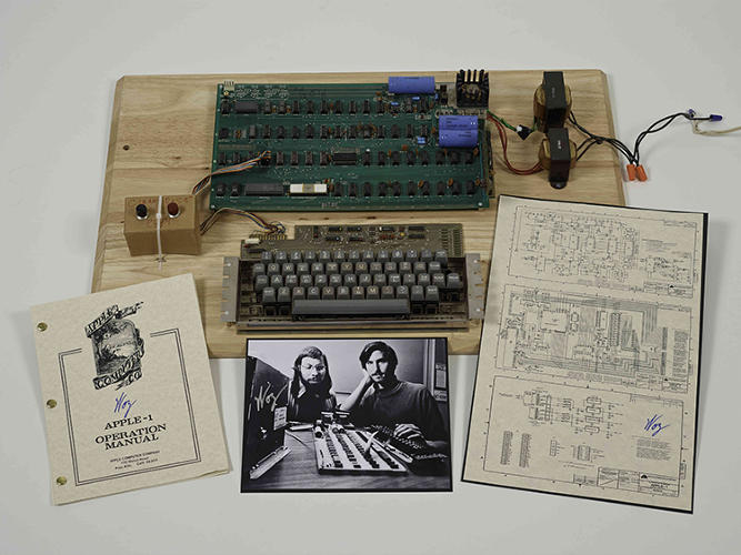 <p>A Christie's online auction of rare and retro Apple products included this Apple-1--the first Apple computer, built by Steve Wozniak in Los Altos in 1967, complete with a signed poster of the Woz and Steve Jobs. It sold for $387,750.</p>