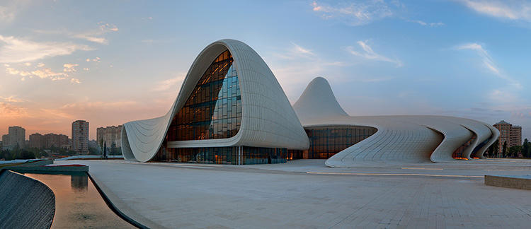 <p>The just-opened Heydar Aliyev Centre in Azerbaijan will give any visitor pause: The building literally emerges from the landscape. It's striking and also indicative of the priority of form that drives most of Hadid's recent work.</p>