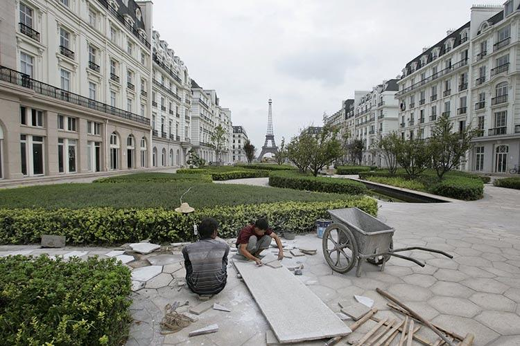 <p>Standing in the middle of the avenue, as workers replace tiles.</p>