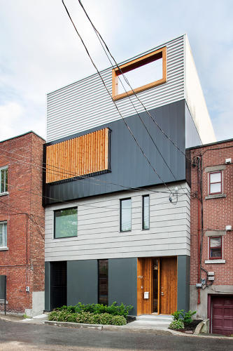 <p>Walk down far enough, and you'll stumble onto the Stacked House, a sterling piece of architecture amid a mishmash of neighboring brick and wood homes.</p>