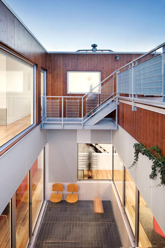 <p>He intervened in several aspect of the design, including fabricating built-in shelves in the living and kitchen areas and installing the stair rail in the courtyard.</p>