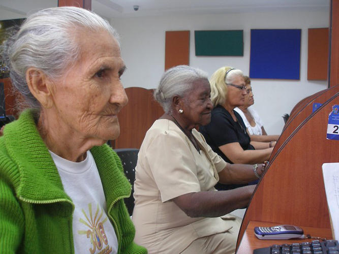 <p>An adult literacy class at Biblioteca Publica del Zulia Maracaibo, Venezuela. In response to marginalization of the poor, disabled, and elderly, Zulia Public Library has developed a range of print and ICT support services to provide citizens with the tools to address national problems from their own perspectives. Older adults, those with disabilities, and other marginalized groups are at the heart of the library's agenda: to ensure access to information for all. Zulia's extended bus services and Braille-adapted equipment were developed to reduce library access barriers faced by these populations.</p>