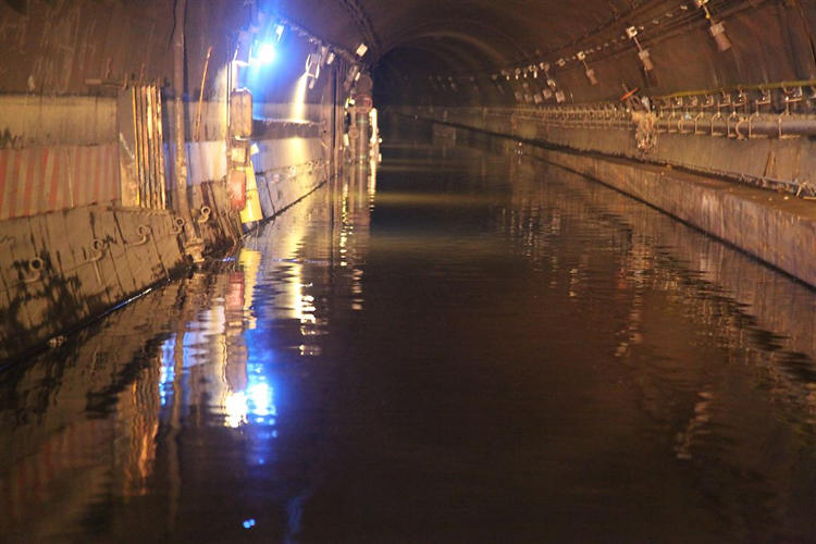 <p>Measuring the water depth in the Cranberry Street Tunnel, full of water.</p>