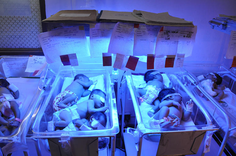<p>Infants are packed together to allow as many infants as possible to receive phototherapy treatment, which potentially spreads infection between them.</p>