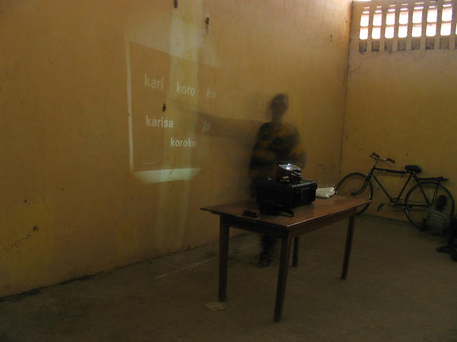 <p>The Kinkajou microfilm is set up for class by a teacher in Mali.</p>