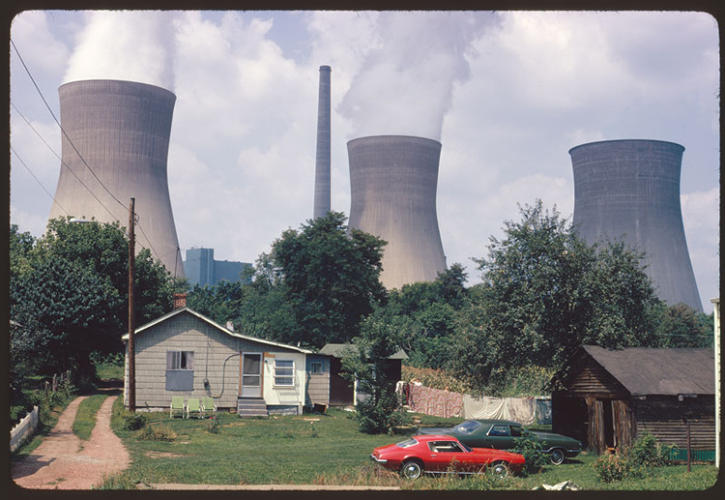 <p>&quot;Water cooling towers of the John Amos Power Plant loom over Poca, WV, home that is on the other side of the Kanawha River. Two of the towers emit great clouds of steam.&quot;</p>  <p>Harry Schaefer, Poca, West Virginia, August 1973(412-DA-8666)</p>