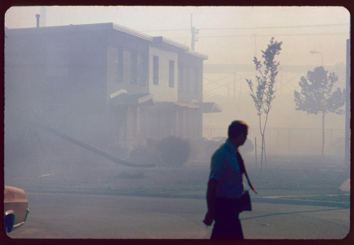 <p>&quot;Industrial smog blacks out homes adjacent to North Birmingham pipe plant. This is the most heavily polluted area of the city.&quot;</p>  <p>Leroy Woodson, Birmingham, Alabama, July 1972. National Archives, Records of the Environmental Protection Agency</p>