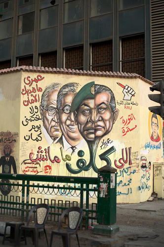 <p>&quot;The military took power soon after Mubarak was ousted but continued to arrest and torture civilians maintaining the strategies that Mubarak had adopted to quell protests. When presidential elections were held, the artist repeated the mural on the same wall in Tahrir Square this time adding two presidential candidates to the mural known to have served during the Mubarak era, once again warning people that voting for them would not bring about change.&quot;</p>