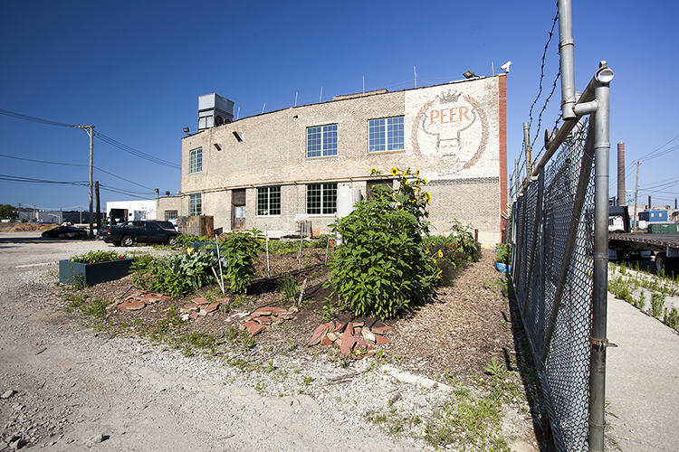<p>The hulking, three-story building stretches an entire city block, and when the renovation is complete, the more than 93,000-square-foot facility will include both indoor and outdoor farms and a variety of commercial food operations.</p>