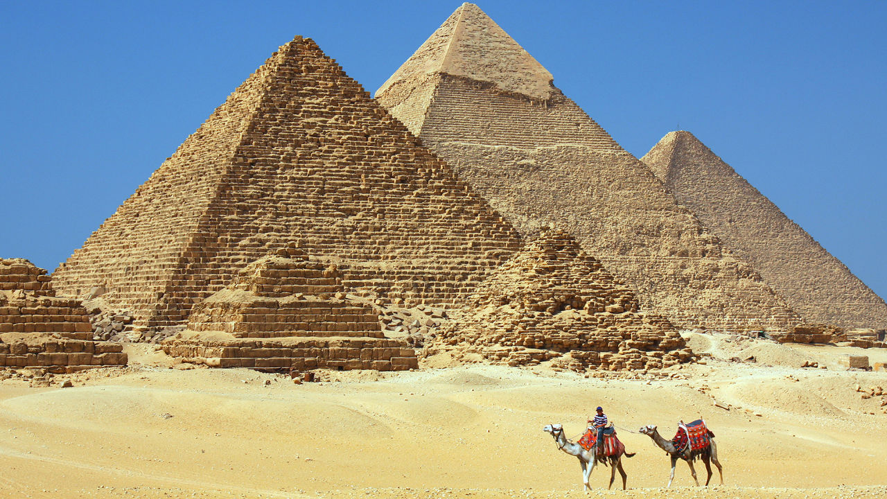 who built the pyramids Introduction: what are pyramids pyramids of ancient kemet (egypt) are large structures with four triangular sides that meet in a point at the top, directly over the.