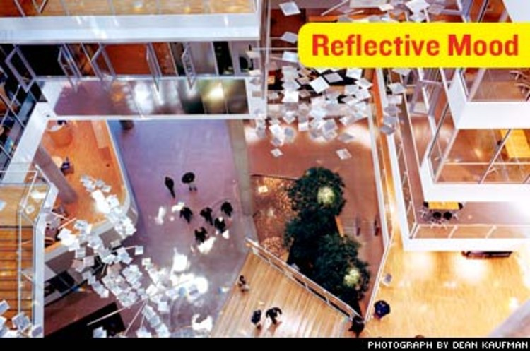 <p>Seven roof-mounted heliostats redirect light down into the atrium through a skylight. The mirror-based system was designed by Bartenbach LichtLabor, which has proposed a village-sized version for the mountainous town of Rattenberg, Austria, where no sun penetrates for much of the winter.</p>