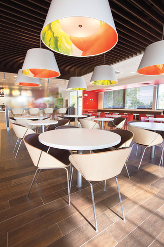 "<p>The ""Fresh + Vibrant"" lounge by Studio Gaia has comfortable, rearrangeable chairs and a coffee bar separated from the chaos of the main retail area by a partition. Near the windows, there is a cafeteria-style dining area with a tiled floor.</p> <p><a class=&quot;float-left&quot; href=&quot;http://www.fastcompany.com/design/2010&quot; target=&quot;_new&quot;><img src=&quot;http://images.fastcompany.com/mod/2010/images/MOD-Logo-LtBckgrnd.gif&quot; alt=&quot;Masters of Design&quot; width=&quot;100&quot; height=&quot;59&quot; /></a></p> <p>Read more about <a href=&quot;http://www.fastcompany.com/magazine/149/super-style-me.html&quot; target=&quot;_new&quot;>McDonald's new design</a>.</p>"