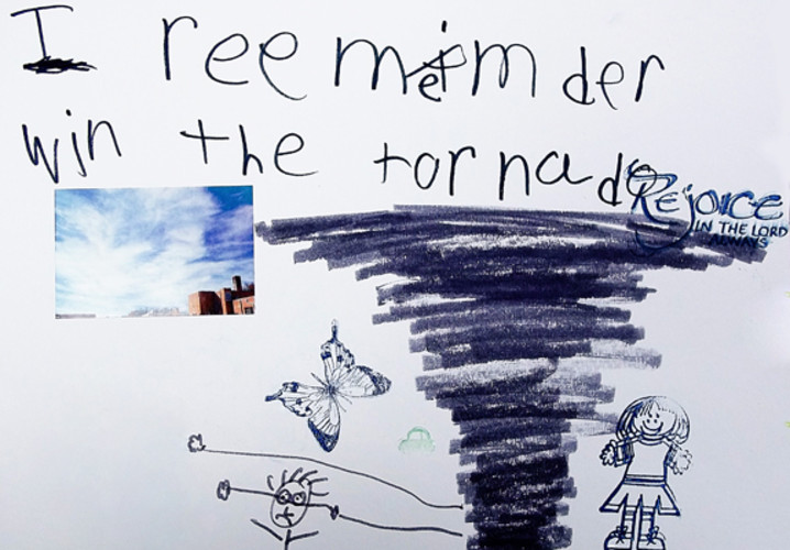 An Irving Elementary first grader drew what he experienced when debris overtook a family member protecting him from the tornado.
