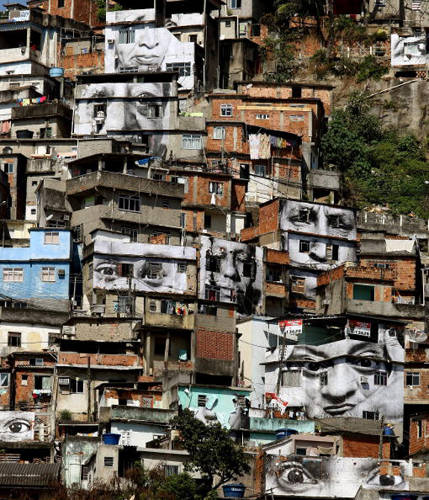 "The hills have eyes in this installation in a Brazilian favela. It's part of a larger JR project called ""Women Are Heroes,"" with other works in Sudan, Sierra Leone, Kenya, Liberia, and elsewhere."