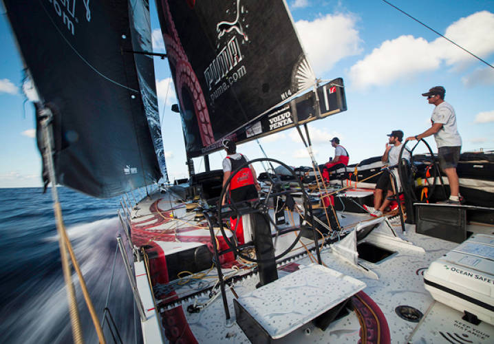 Jonathan Swain helming in light conditions, onboard PUMA Ocean Racing powered by BERG during leg 6 of the Volvo Ocean Race 2011-12, from Itajai, Brazil, to Miami, USA