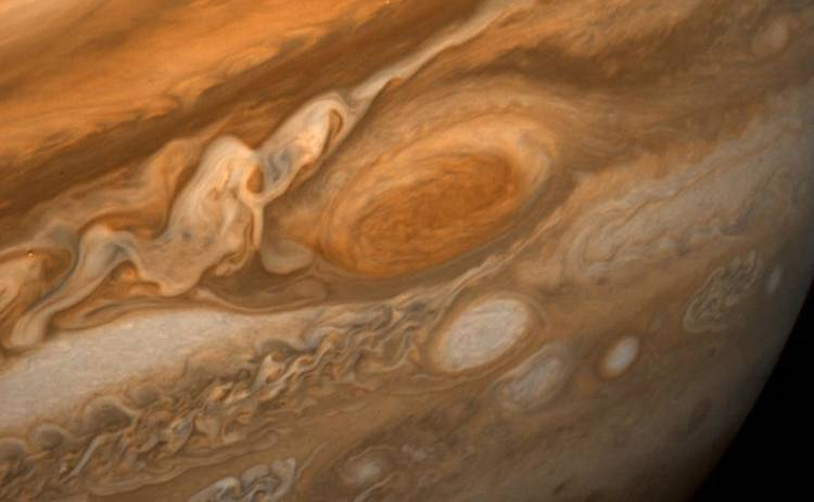 <p>Voyager's images of Jupiter's clouds rank among the most amazing and beautiful space photos ever taken, including this one snapped February 25th, 1979 and showing cloud detail as small as 100 miles across.</p>  <p>The Great Red Spot, Jupiter's prize cloud formation, has fascinated scientists since the early 19th Century because on a planet whose atmosphere is full of whirling clouds and tornados bigger than Earth, the Spot somehow persists for centuries. This is a trick we now explain with Chaos theory, which also helps us understand our own planet's atmosphere and weather.</p>