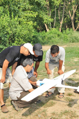 <p>WWF Nepal staff learning about drone's features</p>