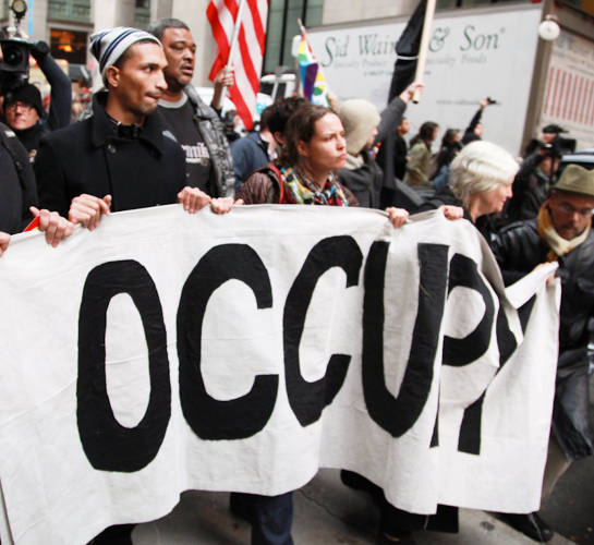 <p>During the Occupy Wall Street protests that began in September 2011, the camp set up in New York City's Zuccotti Park lacked an amplified sound system. So protesters created the &quot;people's mic,&quot; a system for making announcement in which the speaker would say something that the crowd would repeat, in groups, until the message was fully disseminated. The technique, which reinforced the movement's emphasis on decentralized experience, caught on in cities as far away as Oakland, California.</p>  <p><a href=&quot;http://www.flickr.com/photos/palinopsiafilms/6359690341/in/photolist-aFZ5nt-aFcLbX-aJpjsv-aFZebF-aJpo5c-aFZabP-aJpkct-aFYbMT-aJphrz-aJpjTZ-aFY8Sp-aFZ56D-aJppD4-aFYdCe-aFZ7Xr-aJphz4-aJpjzV-aFYgiV-aJpnuR-aFZ7qg-aJpmnp-aFZ9fX-aFZ8Xg-aJpmFM-aFYa48-aFY69K-aFYb4R-aFYh8t-aFZ5VM-aFZdVK-aFZ6Cx-aJphhx-aJpj4i-aJpk3i-aJprg2-aFZbSP-aFZdz6-aFcM1r-aJphNi-aJpi5T-aJpn6a-aJpicR-aFZ7ar-aFcLMa-aJpr6k-aJpqy2-aFZ4Tc-aFY6Kv-aFZarp-aJpmPr-aJpqJ6/&quot; target=&quot;_blank&quot;>Flickr user Coco Curranski</a></p>