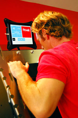 <p>When members enter a Fitwall, instead of being greeted at a welcome desk, they make their way to a wall-mounted iPad to check in.</p>