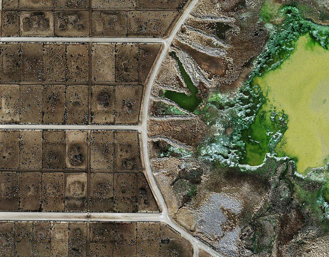 <p>At first glance, British artist Mishka Henner's aerial photographs of large feedlots--features of industrial beef farming--don't look like shots of land at all.</p>  <p>Tacosa Feedyard's waste lagoon, Texas (2013).</p>