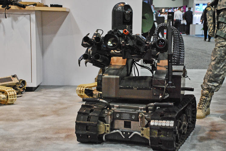 <p>QinetiQ MAARS rover is the size of a large dog and is mounted with guns and grenade launchers.</p>