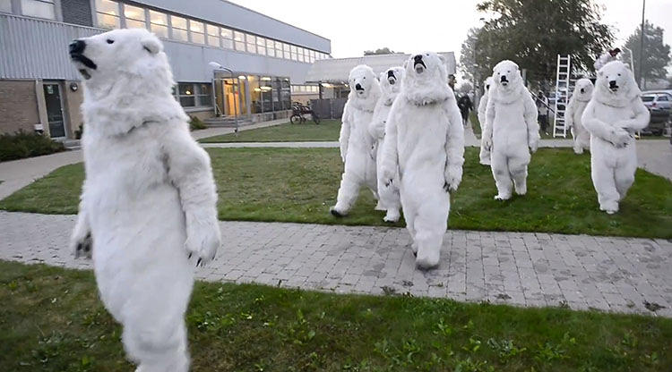 <p>On Wednesday, 35 Greenpeace activists, some dressed as polar bears, snuck into Shell's largest Danish refinery at 6 a.m., then scaled its huge smokestacks and oil tanks to unfurl a rebranded Shell logo.</p>
