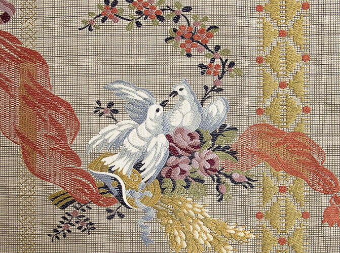 <p>The scenery is bucolic, complete with doves, flowers, and ears of corn. The pattern--sourced from a sample from the museum's own collection--is given a contemporary update via the gridded background on which the figural elements are superimposed.</p>