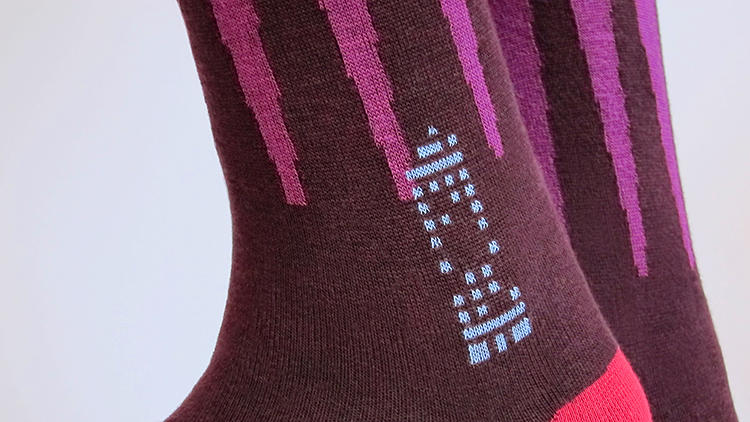 <p>Each XOAB sock has its own unique pattern of stitches--a textile barcode--that allows it to be uniquely identified.</p>