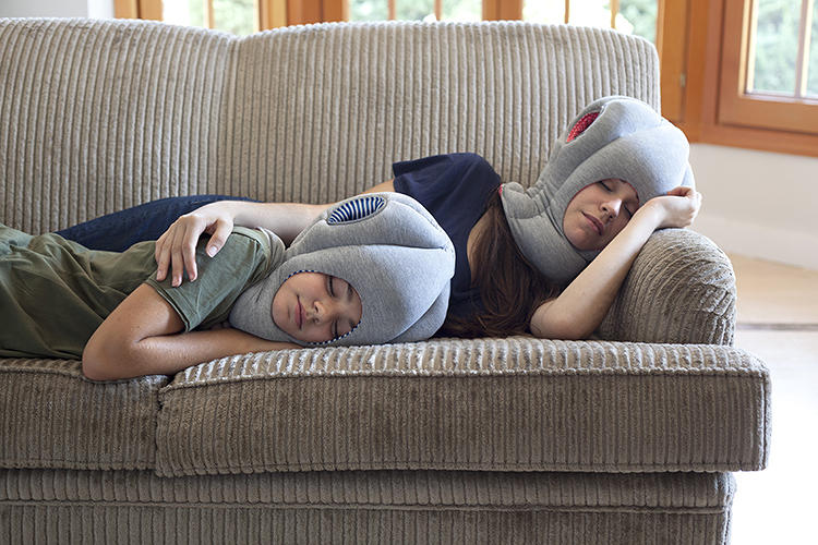 <p>What's that thing on your head? It's the Ostrich Pillow and Ostrich Pillow Junior, portable, wearable sleeping devices designed to catch sleep on the go. (Or even when you're just at home.)</p>