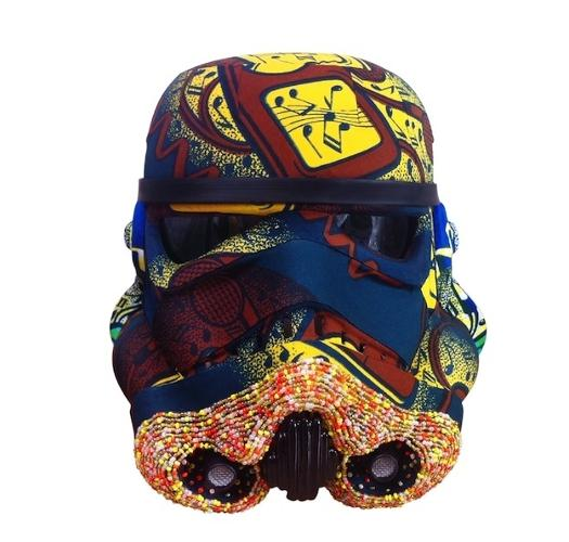 <p>Rocking out with a beard of beads.</p>  <p>Yinka Shonibare, iPod Invader, 2013. Courtesy: Art Wars. David Bailey helmet. Acrylic Capped ABS Storm Trooper head painted by David Bailey. 2013. Signed by David Bailey and Andrew Ainsworth. Image: Bran Symondson</p>
