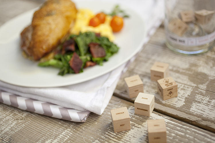 <p>The wooden, laser-cut dice come packaged in up-cycled wine bottle tumblers.</p>
