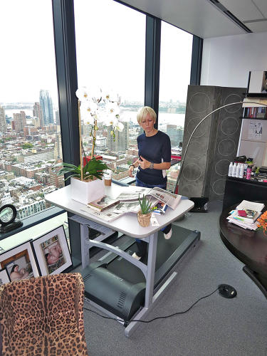 <p>Joanna Coles, editor in chief of <em>Cosmopolitan</em>, takes time for analog tasks like reading the paper at her treadmill desk. &quot;It mitigates the exercise panic that sets in around 4:30.&quot;</p>