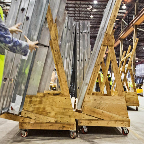 <p>Wall frames move around the factory by custom-built dolly carts.</p>