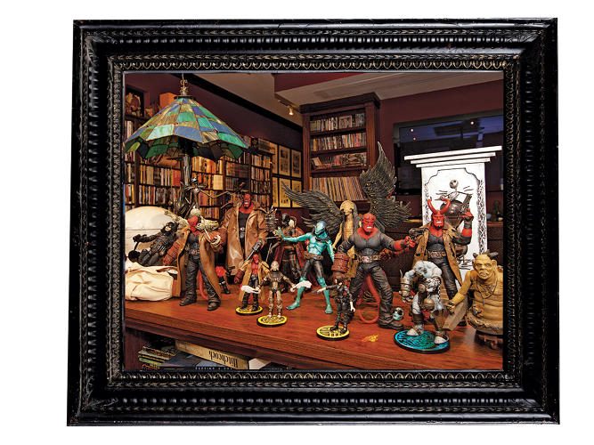 <p><em>Hellboy</em> action figures strike a pose in del Toro's &quot;Bleak House&quot; library.</p>